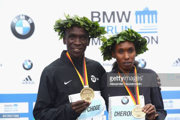 Eliud Kipchoge of Kenya and Gladys Cherono of Kenya celebrate at the victory ceremony winning the BMW Berlin Marathons 2017 on September 24 2017 in...