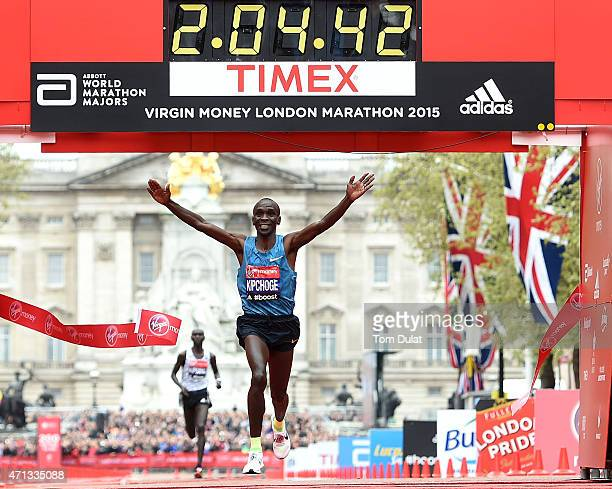 Eliud Kipchoge of Kenya celebrates after winning the Men's race during the Virgin Money London Marathon on April 26 2015 in London England