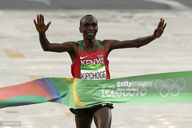 Eliud Kipchoge of Kenya celebrates as he crosses the line to win gold during the Men's Marathon on Day 16 of the Rio 2016 Olympic Games at Sambodromo...