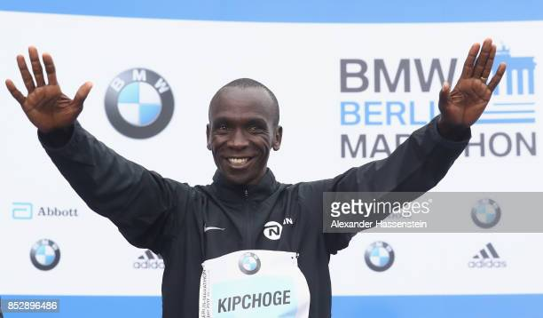 Eliud Kipchoge of Kenya celebrates at the victory ceremony winning the BMW Berlin Marathon 2017 on September 24 2017 in Berlin Germany