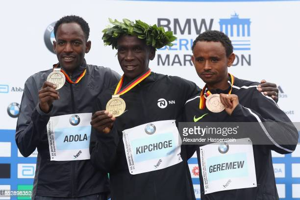 Eliud Kipchoge of Kenya celebrates winning the BMW Berlin Marathon 2017 with Guye Adola of Ethiopia who wons the 2nd place and Mosinet Geremew of...