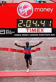 Eliud Kipchoge of Kenya crosses the finish line to win the Men's race during the Virgin Money London Marathon on April 26 2015 in London England