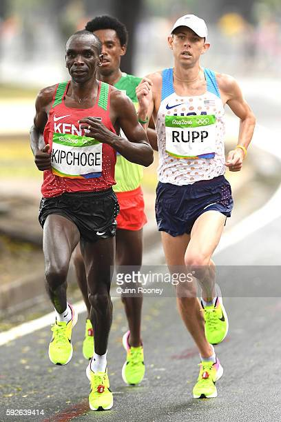 Eliud Kipchoge of Kenya Galen Rupp of the United States and Feyisa Lilesa of Ethiopia compete during the Men's Marathon on Day 16 of the Rio 2016...