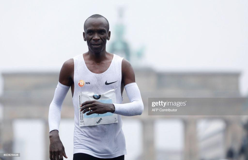 Eliud Kipchoge of Kenya smiles after winning the Berlin Marathon on September 24, 2017 in Berlin. /