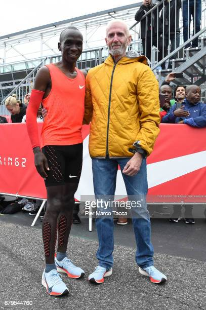 Eliud Kipchoge poses with Sandy Bodecker VP action Sport at Nike at the finish area during the Nike Breaking2 SubTwo Marathon Attempt at Autodromo di...