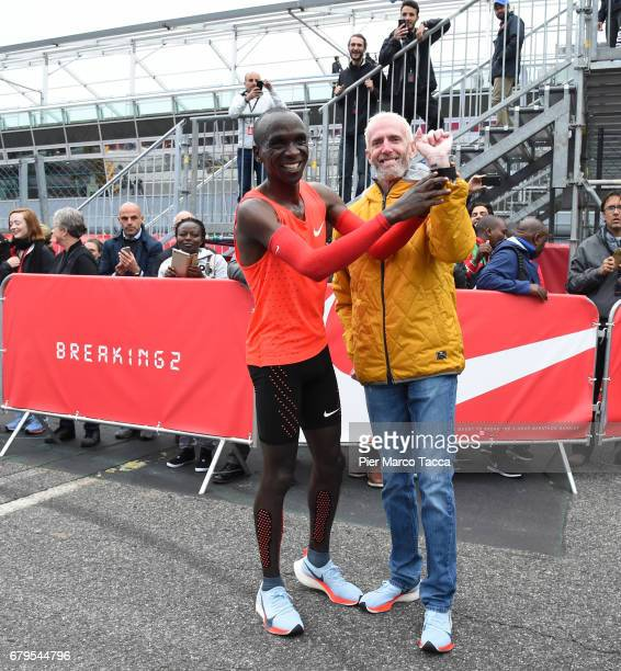 Eliud Kipchoge shows Sandy Bodecker's tattoo at the finish area during the Nike Breaking2 SubTwo Marathon Attempt at Autodromo di Monza on May 6 2017...