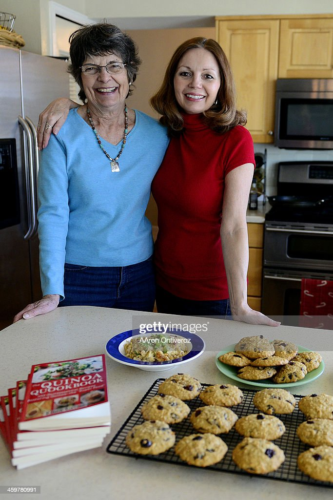 Eliza Cross, who wrote The Quinoa Quoobook, poses with her mother Betty Crosslen, who drew the book's illustrations. Cross cooks at her home on Monday, December 30, 2013.
