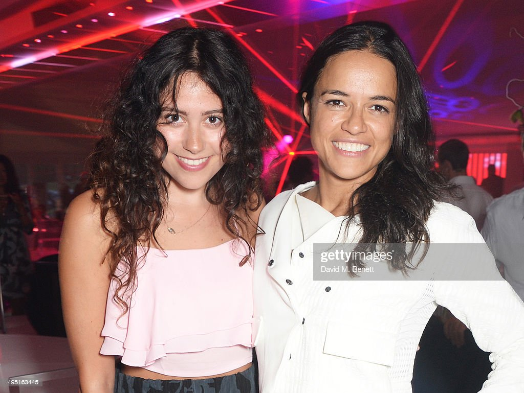 Eliza Doolittle (L) and Michelle Rodriguez attend day two of the Audi Polo Challenge at Coworth Park Polo Club on June 1, 2014 in Ascot, England.