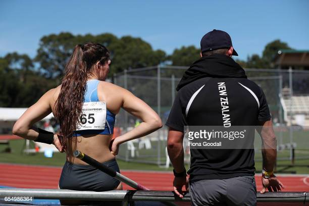Eliza McCartney of Auckland chats to her coach Jeremy McColl while she competes in the women's Pole Vault during the New Zealand Track Field...