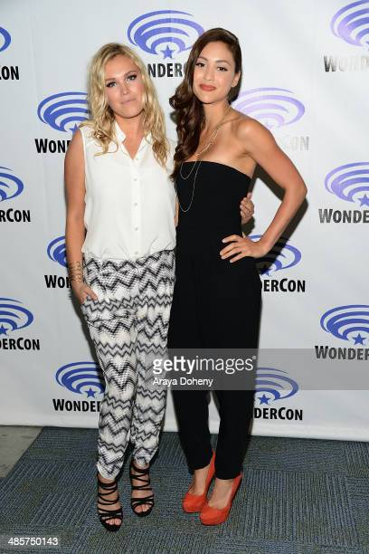 Eliza Taylor and Lindsey Morgan attend The 100 press line at WonderCon Anaheim 2014 Day 2 at Anaheim Convention Center on April 19 2014 in Anaheim...