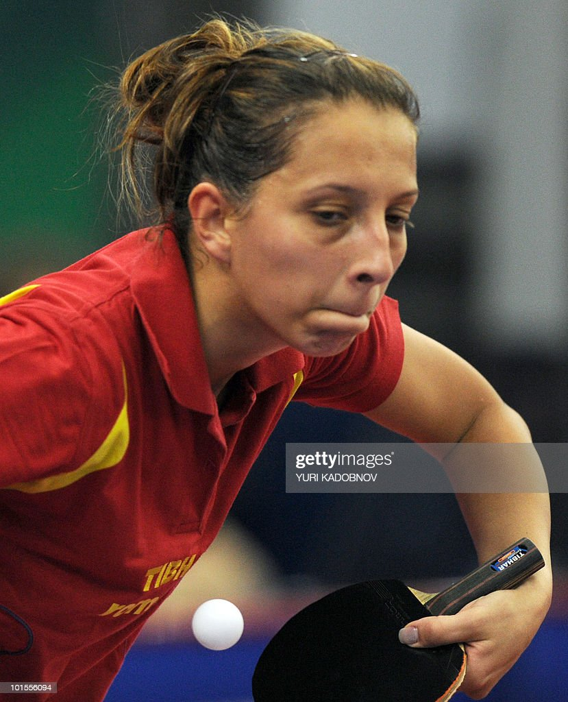 Elizabeta Samara of Romania returns a service to Ai Fukuhara of Japan during their women's teams group D match at the 2010 World Team Table Tennis Championships in Moscow on May 26, 2010.