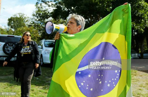 Elizabete Monteiro and other demonstrators protest against the release from prison of former Brazilian politician and the chief of staff to Lula da...