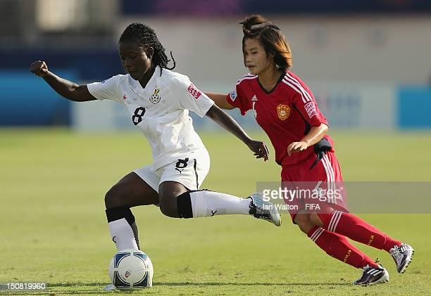 Elizabeth Addo of Ghana wins the ball ahead of Luo Guiping of China during the FIFA U20 Women's World Cup Japan 2012 Group D match between China v...