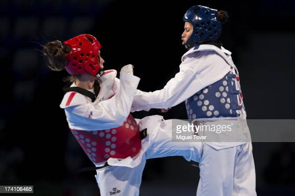 Elizabeth Alvarado of Peru competes with Amanda Sanchez of Costa Rica during a women's 57 kg combat of WTF World Taekwondo Championships 2013 at the...