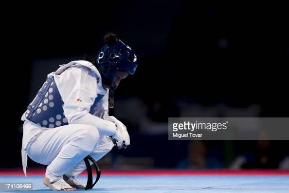 Elizabeth Alvarado of Peru reacts after losing against Amanda Sanchez of Costa Rica during a women's 57 kg combat of WTF World Taekwondo...