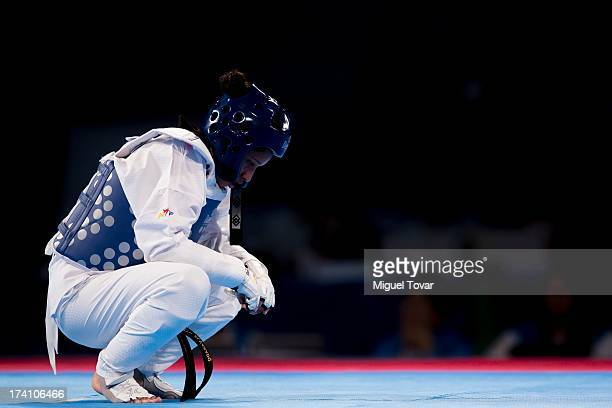 Elizabeth Alvarado of Peru reacts after losing against Amanda Sanchez of Costa Rica during a women's 57 kg combat of WTF World Taekwondo...