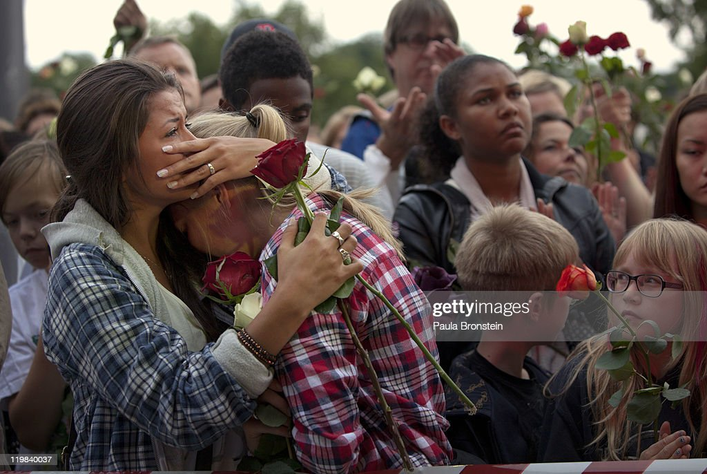 Elizabeth Amundsen,16, (L) and Tiril Killi, 16, comfort each other as hundreds of thousands of people gather at a memorial vigil following Friday's twin extremist attacks, July 25, 2011 in Oslo, Norway. Anders Behring Breivik, 32, claimed that he has 'two more cells' working with him as he appeared in court today following a bomb blast at a government building in Oslo and a shooting massacre on nearby Utoya Island that killed at least 76 people in all. The death toll was originally reported as 93.