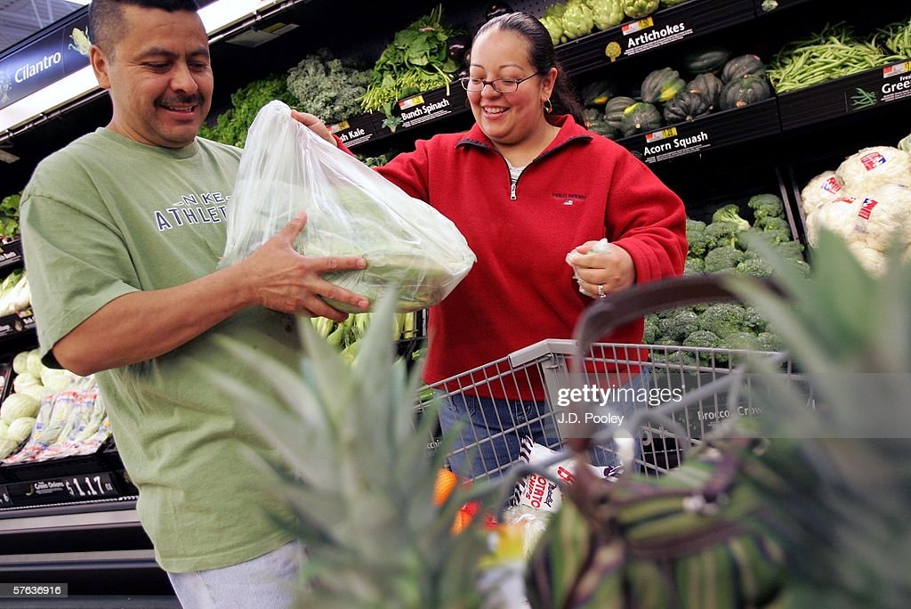Elizabeth (R) and Silvestre Gonzalez buy produce at the new 2,000 square foot Wal-Mart Supercenter store May 17, 2006 in Bowling Green, Ohio. The new store, one of three new supercenters opening today in Ohio, employs 340 people with 60 percent of those working full-time.