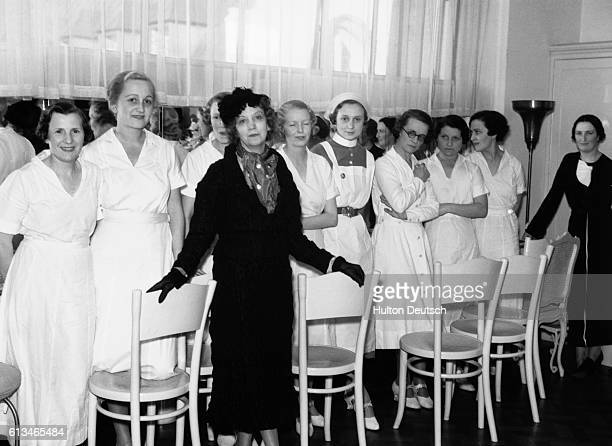 Elizabeth Arden the American beautician and businesswoman with some of her staff 1935 She established a chain of salons and a her own brand of...