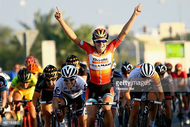 Elizabeth Armitstead of Great Britain and Boels Dolmans Cycling celebrate after winning stage three of the 2015 Ladies Tour of Qatar from Souq Waqif...