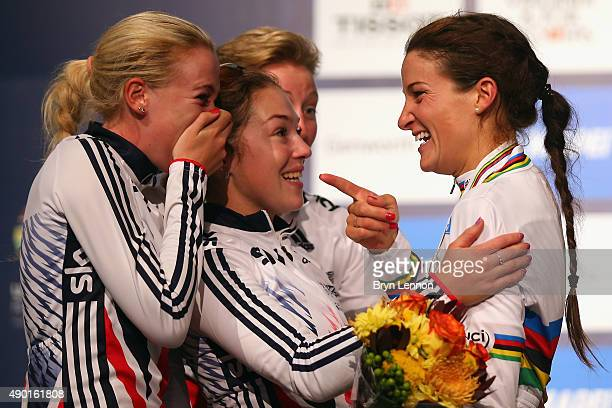 Elizabeth Armitstead of Great Britain celebrates with team mates Jessie Walker and Lucy Garner for the Elite Women's Road Race on day seven of the...