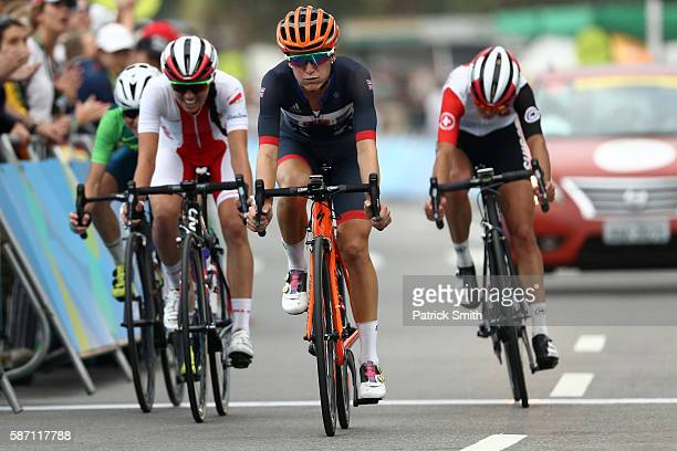 Elizabeth Armitstead of Great Britain crosses the finish line to finish 5th during the Women's Road Race on Day 2 of the Rio 2016 Olympic Games at...