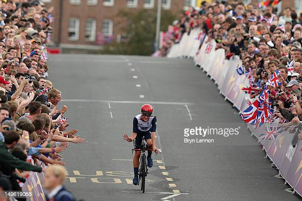 Elizabeth Armitstead of Great Britain waves to the crowds after the Women's Individual Time Trial Road Cycling on day 5 of the London 2012 Olympic...