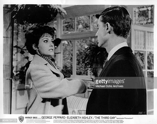 Elizabeth Ashley slaps her cousin Roddy McDowall after a family spat in a scene from the Warner Bros movie 'The Third Day' circa 1965