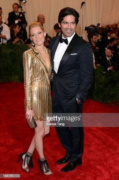 Elizabeth Banks and Brian Atwood attend the Costume Institute Gala for the 'PUNK Chaos to Couture' exhibition at the Metropolitan Museum of Art on...