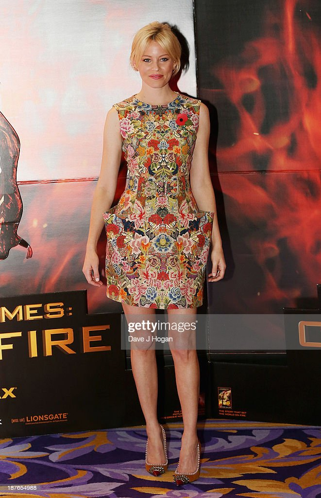 Elizabeth Banks attends a photocall for 'The Hunger Games: Catching Fire' at Corinthia Hotel London on November 11, 2013 in London, England.