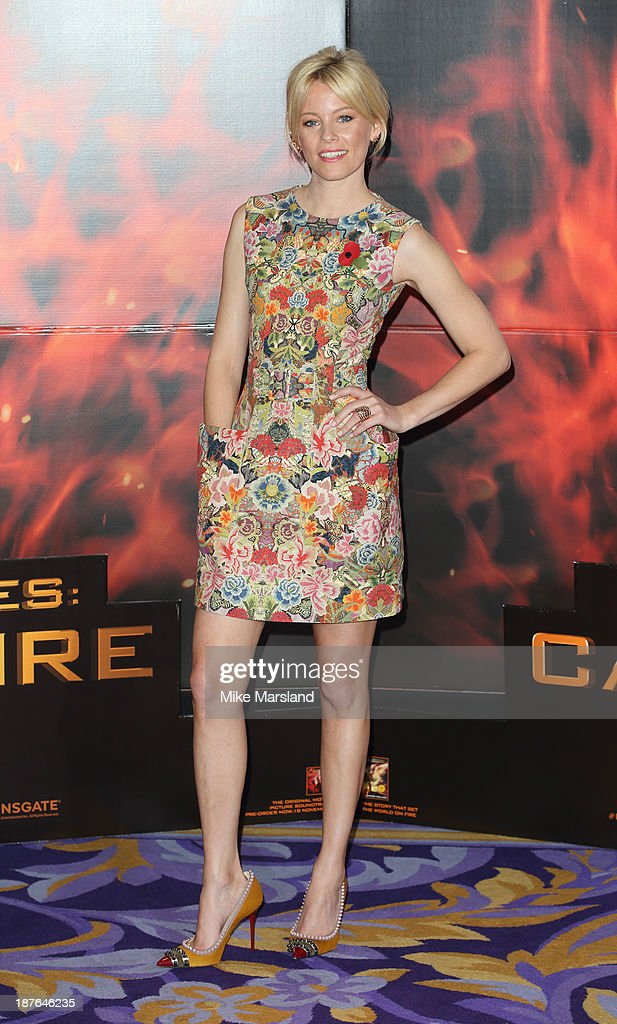 <a gi-track='captionPersonalityLinkClicked' href=/galleries/search?phrase=Elizabeth+Banks&family=editorial&specificpeople=202475 ng-click='$event.stopPropagation()'>Elizabeth Banks</a> attends a photocall for 'The Hunger Games: Catching Fire' on November 11, 2013 in London, England.