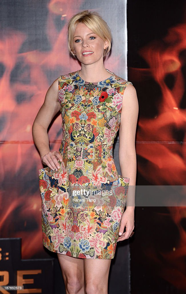 Elizabeth Banks attends a photocall for 'The Hunger Games: Catching Fire' held at the Corinthia Hotel on November 11, 2013 in London, England.