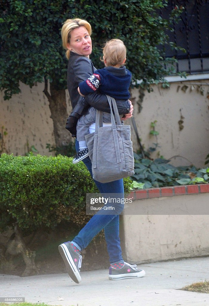 Elizabeth Banks is seen taking a walk with her son, Magnus Handelman on December 09, 2013 in Los Angeles, California.