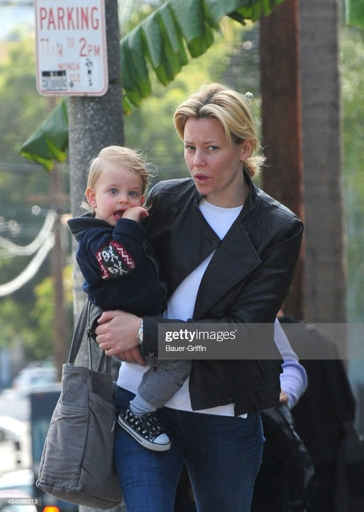 Elizabeth Banks is seen taking a walk with her son, Magnus Handelman on December 09, 2013 in Los Angeles, California.