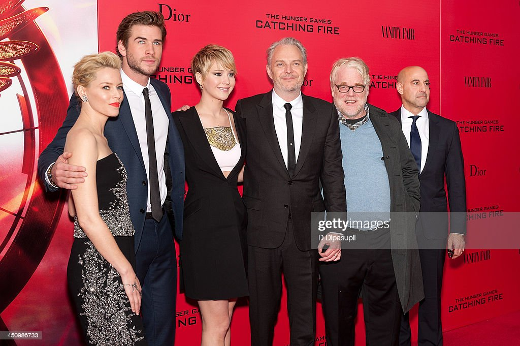 Elizabeth Banks Liam Hemsworth Jennifer Lawrence director Francis Lawrence Philip Seymour Hoffman and Stanley Tucci attend the 'Hunger Games Catching...