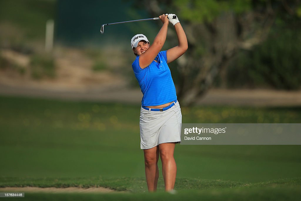 Elizabeth Bennett of England plays her second shot at the par 4, 9th hole during the first round of the 2012 Omega Dubai Ladies Masters on the Majilis Course at the Emirates Golf Club on December 5, 2012 in Dubai, United Arab Emirates.
