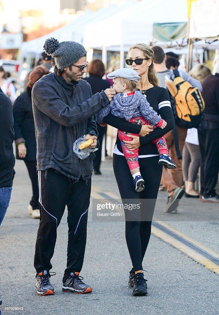 Elizabeth Berkley and Greg Lauren with their son Sky Lauren are seen on December 15 2013 in Los Angeles California