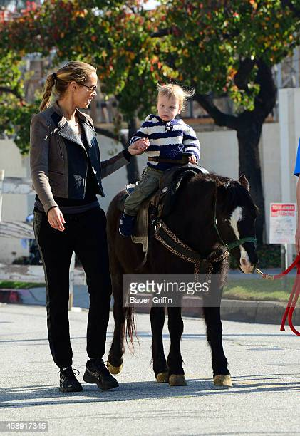 Elizabeth Berkley and her son Sky Cole Lauren are seen at the Studio City Farmers Market on December 22 2013 in Los Angeles California