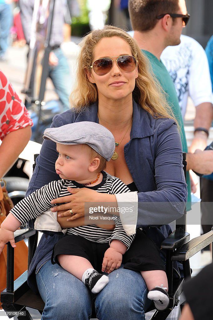 Elizabeth Berkley and her son Sky Cole Lauren vist 'Extra' at The Grove on June 6, 2013 in Los Angeles, California.
