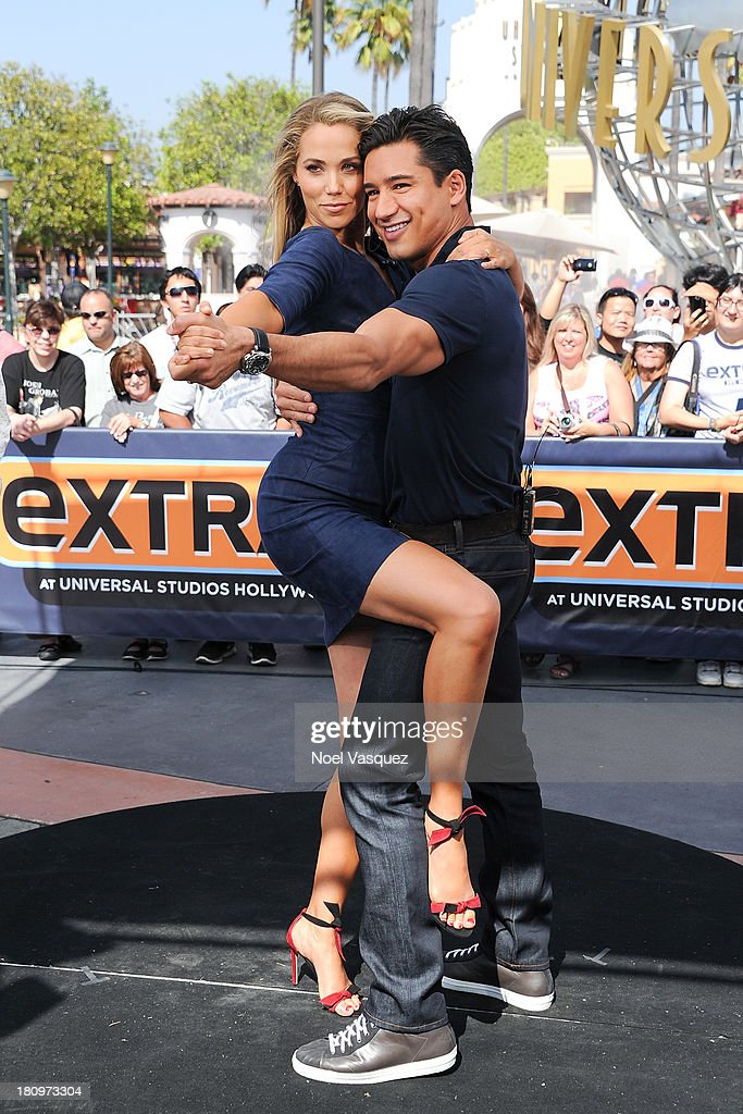 Elizabeth Berkley dances with <a gi-track='captionPersonalityLinkClicked' href=/galleries/search?phrase=Mario+Lopez&family=editorial&specificpeople=235992 ng-click='$event.stopPropagation()'>Mario Lopez</a> at 'Extra' at Universal Studios Hollywood on September 18, 2013 in Universal City, California.