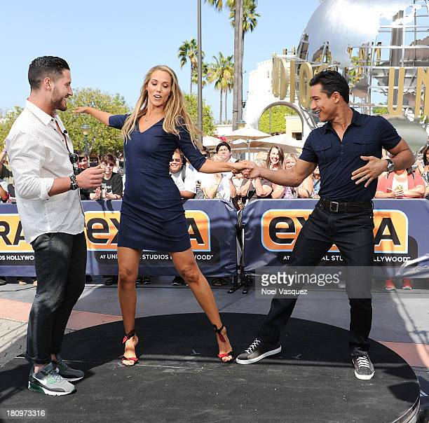 Elizabeth Berkley dances with Mario Lopez at 'Extra' at Universal Studios Hollywood on September 18 2013 in Universal City California