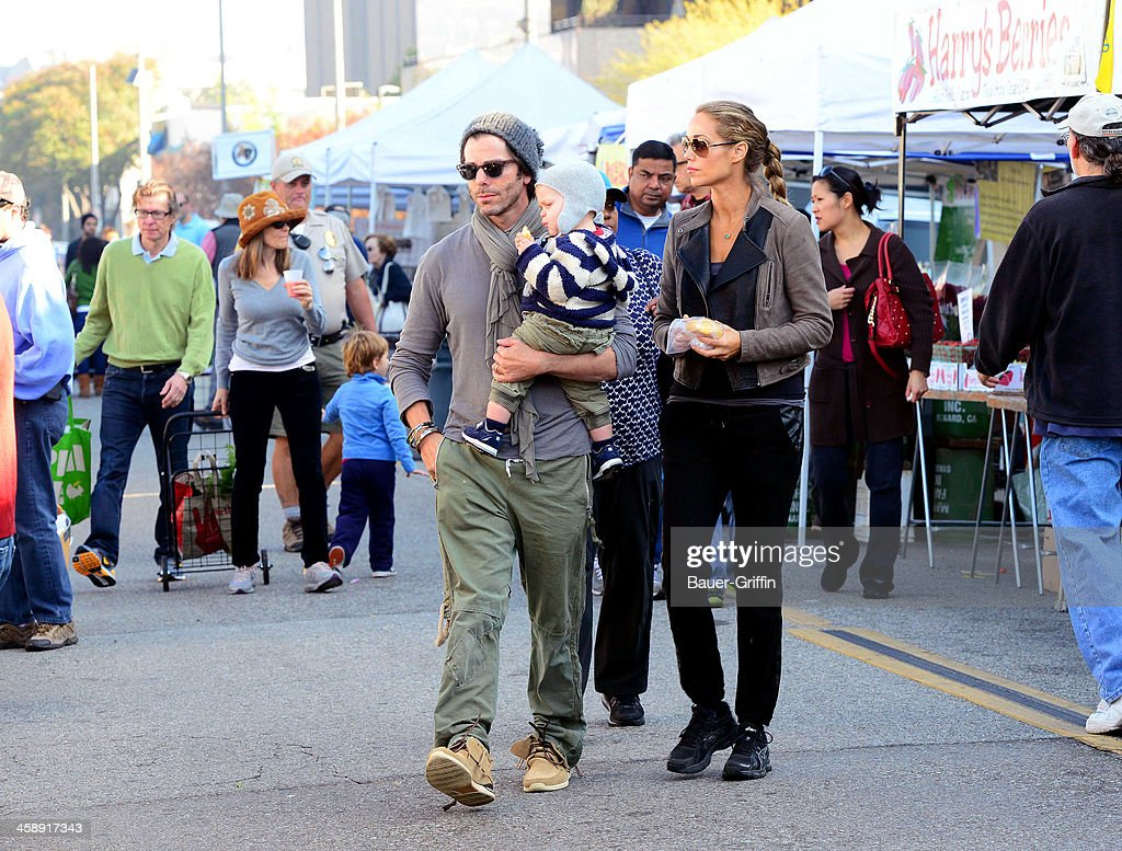 Elizabeth Berkley, Greg Lauren and their son, Sky Cole Lauren, are seen at the Studio City Farmers Market on December 22, 2013 in Los Angeles, California.