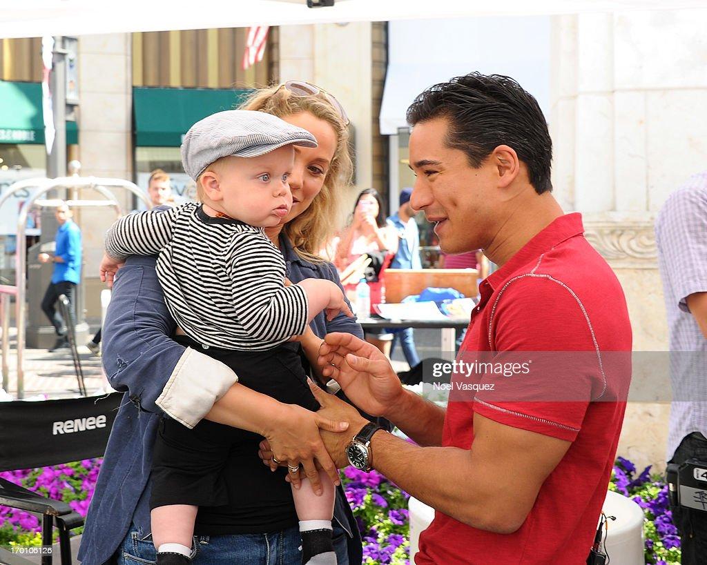 Elizabeth Berkley, her son Sky Cole Lauren and Mario Lopez visit 'Extra' at The Grove on June 6, 2013 in Los Angeles, California.