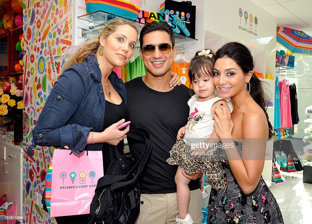 Elizabeth Berkley, <a gi-track='captionPersonalityLinkClicked' href=/galleries/search?phrase=Mario+Lopez&family=editorial&specificpeople=235992 ng-click='$event.stopPropagation()'>Mario Lopez</a>, baby daughter Gia Francesca and wife <a gi-track='captionPersonalityLinkClicked' href=/galleries/search?phrase=Courtney+Mazza&family=editorial&specificpeople=5650960 ng-click='$event.stopPropagation()'>Courtney Mazza</a> attends the Dylan's Candy Bar Los Angeles Opening at Original Farmers Market on September 8, 2012 in Los Angeles, California.