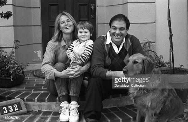 Elizabeth Burkit Stone wife of Oliver Stone poses for a portrait session with her son Sean Stone and husband director Oliver Stone at home in circa...
