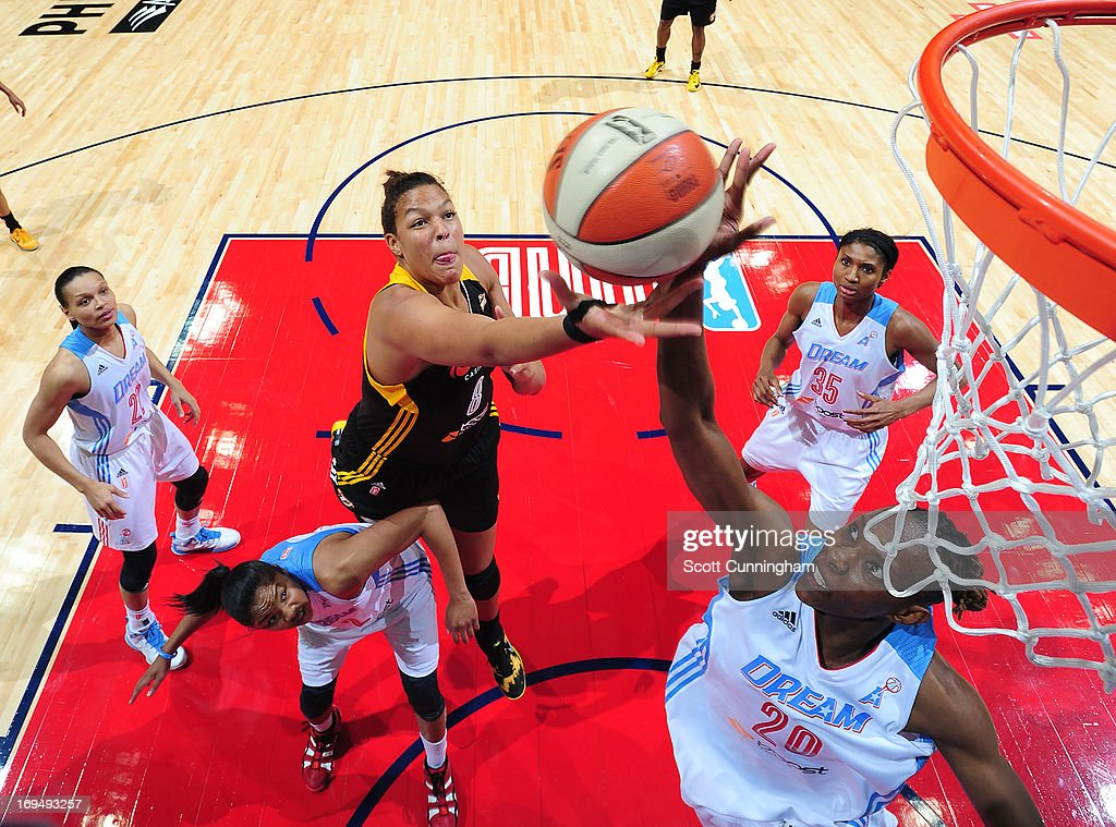 Elizabeth Cambage #8 of the Tulsa Shock battles for a rebound against Sancho Lyttle #20 of the Atlanta Dream at Philips Arena on May 25, 2013 in Atlanta, Georgia.