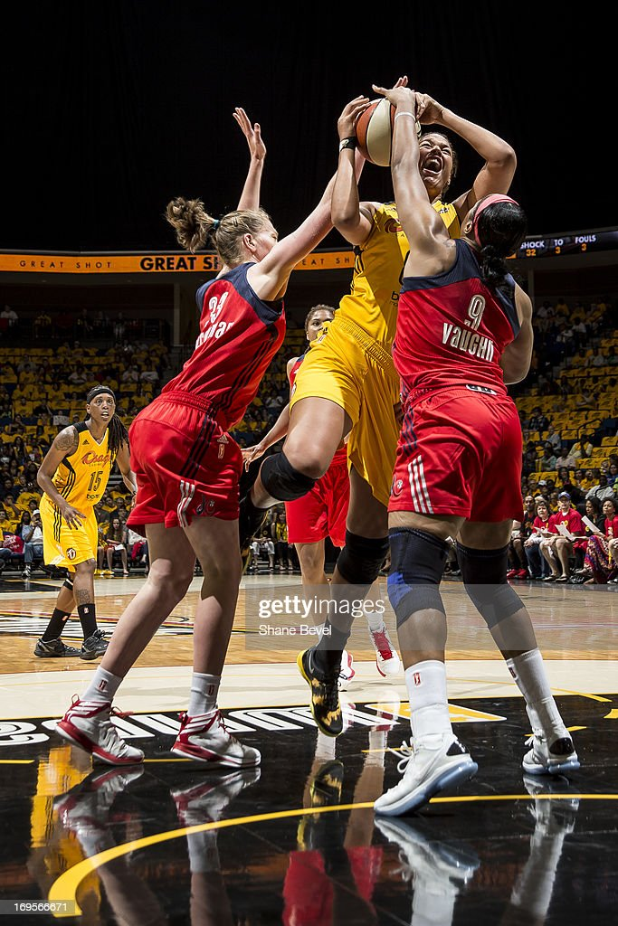Elizabeth Cambage of the Tulsa Shock gets blocked by Emma Meesseman and Kia Vaughn of the Washington Mystics during the WNBA game on May 27 2013 at...