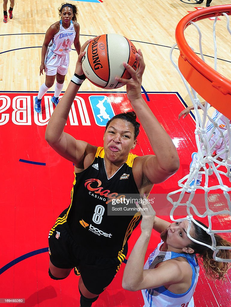 Elizabeth Cambage #8 of the Tulsa Shock grabs a rebound against the Atlanta Dream at Philips Arena on May 25, 2013 in Atlanta, Georgia.