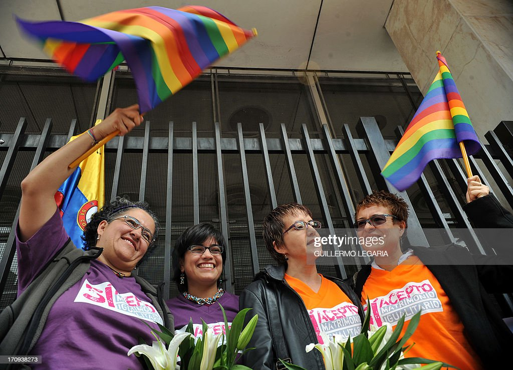 Elizabeth Castillo (L), Claudia Zea (2nd-L), Sandra Marcela Rojas (2nd-R), and Adriana Gonzalez (R) pose for photos outside the court in Bogota, Colombia, on June 20, 2013, before filling documents to apply for registration of their marriage. From today Colombia will enter into a legal puzzle on gay marriage, as gay couples will go to notaries and judged without knowing if they will come out with the document as desired, given the legal vacuum that persists for such unions. AFP PHOTO/Guillermo LEGARIA