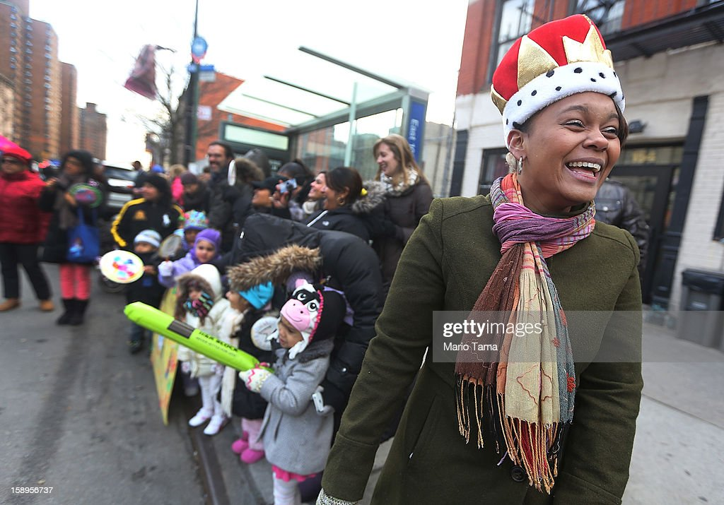 Elizabeth Castillo (R) wears a king hat during the Three Kings Day Parade in East Harlem on January 4, 2013 in New York City. The parade celebrates the Feast of the Epiphany, also known as Three Kings Day, marking the Biblical story of the visit of three kings to Bethlehem to visit the baby Jesus, revealing his divinity.